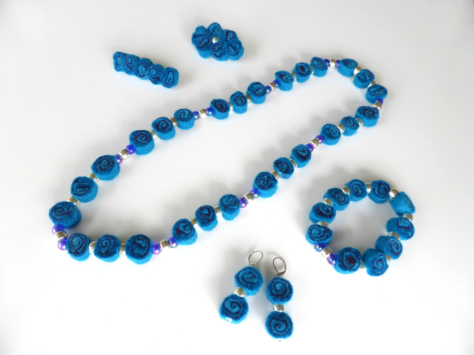 Blue Felt Spiral Jewellery by Andrea McCallum