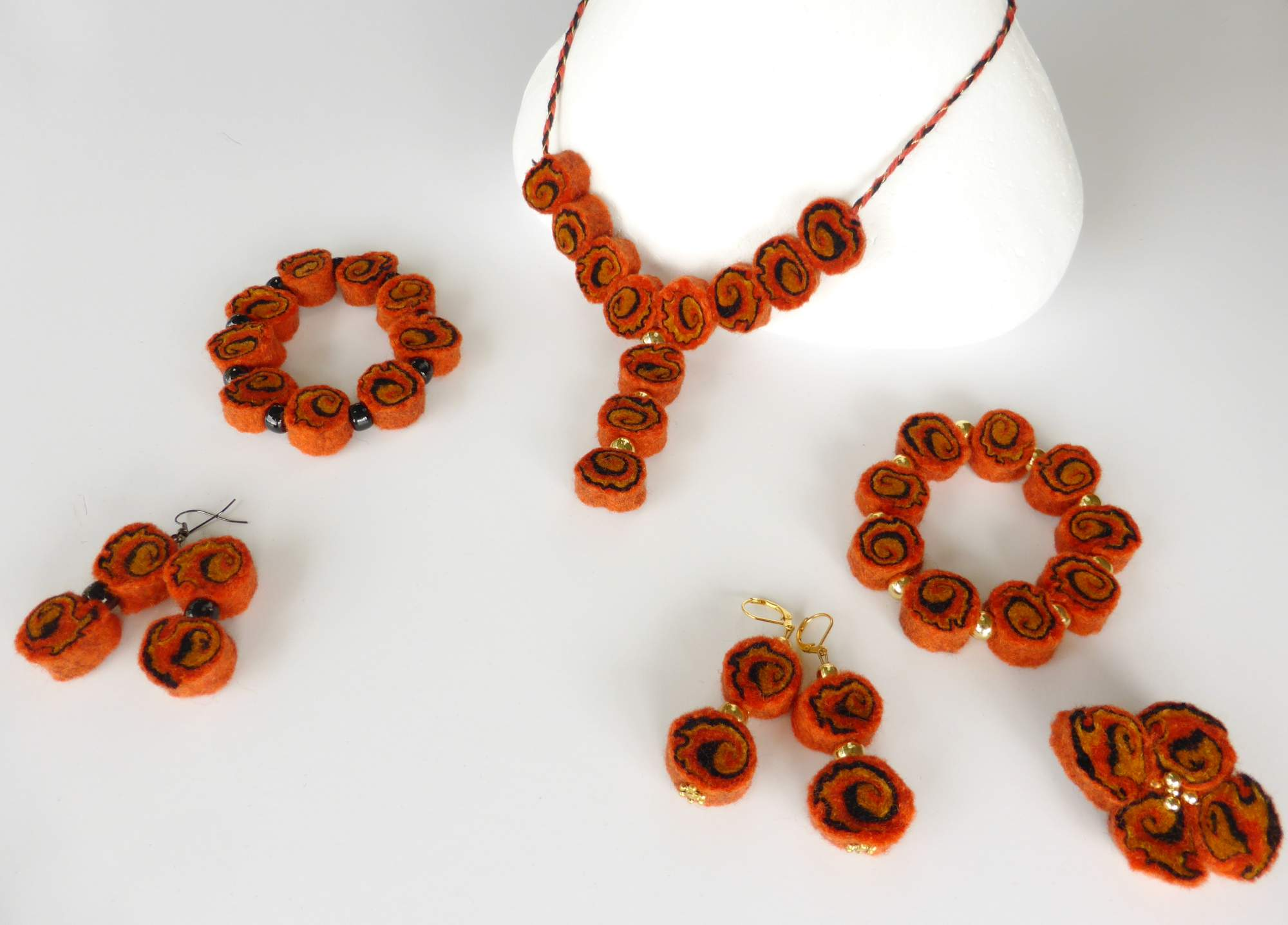 Orange Felt Spiral Jewellery by Andrea McCallum