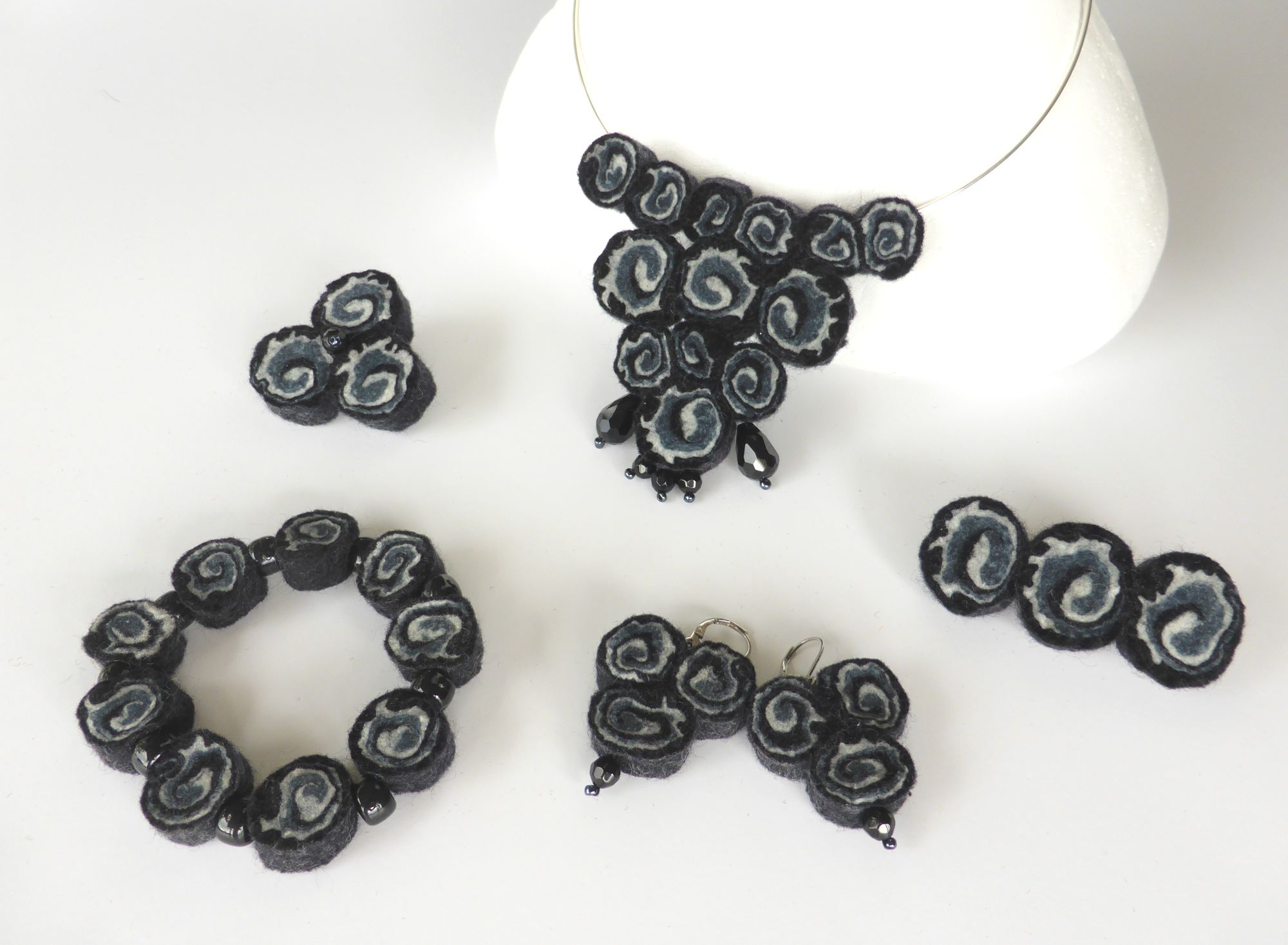 Black felt spiral jewellery necklace (2015) by Andrea McCallum